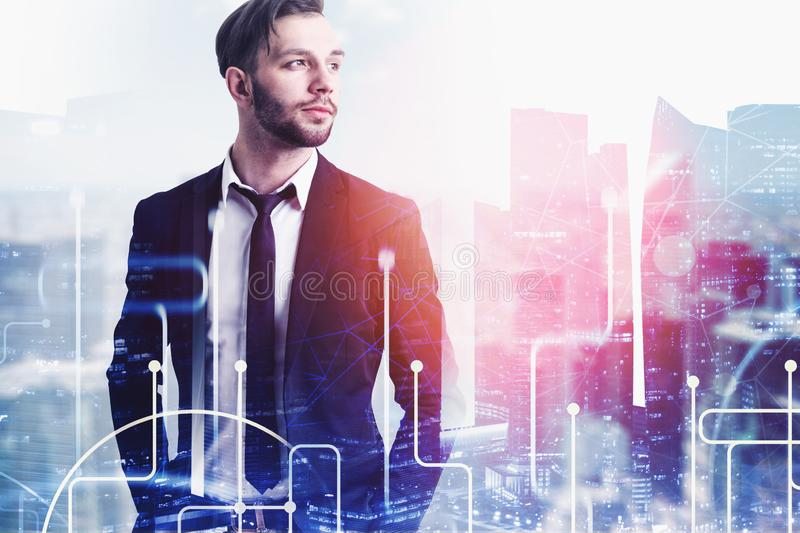 Confident businessman in city, network royalty free stock photo