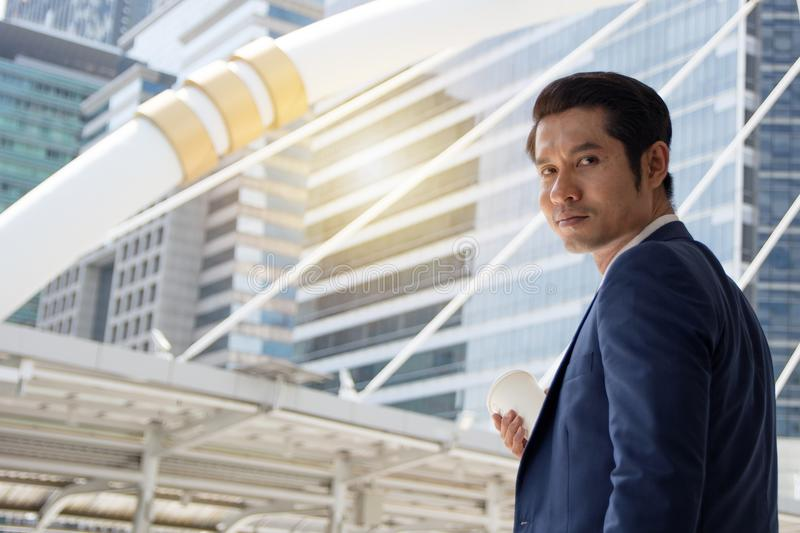 Confident businessman with coffee cup stock photos
