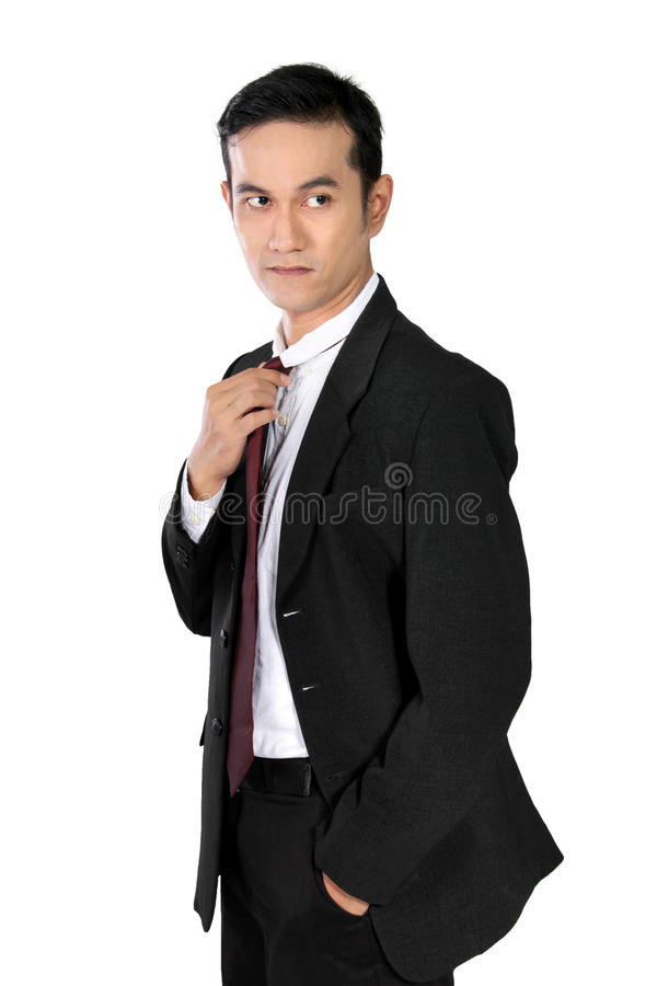 Confident businessman in cool pose, isolated on white royalty free stock photography