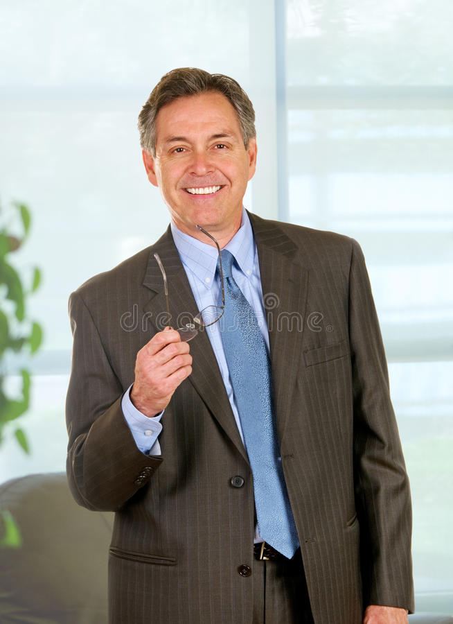 Confident Businessman In Corner Office stock image
