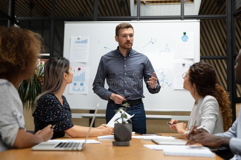 Confident businessman executive talk to employees during corporate briefing stock images