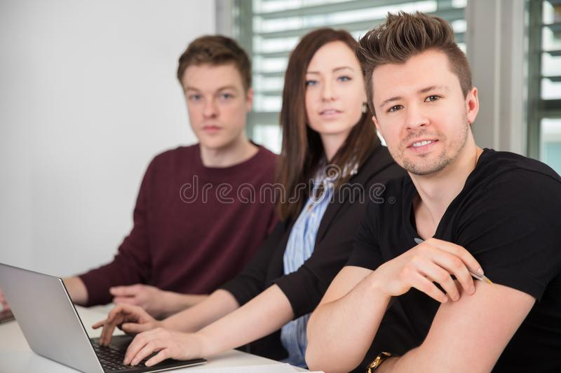 Confident Businessman With Female Colleague In Office royalty free stock photos