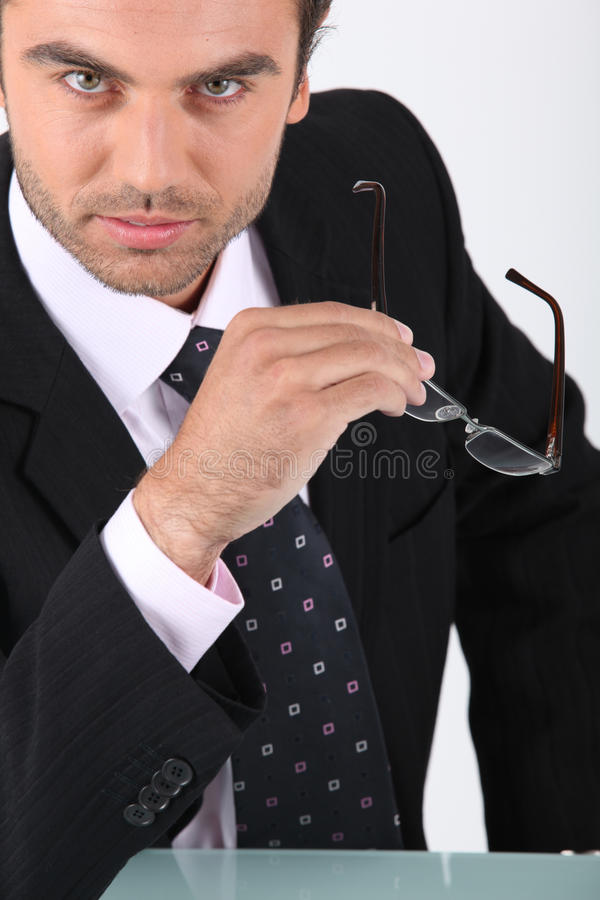 Download Confident Businessman Holding Glasses Stock Photo - Image: 24018828