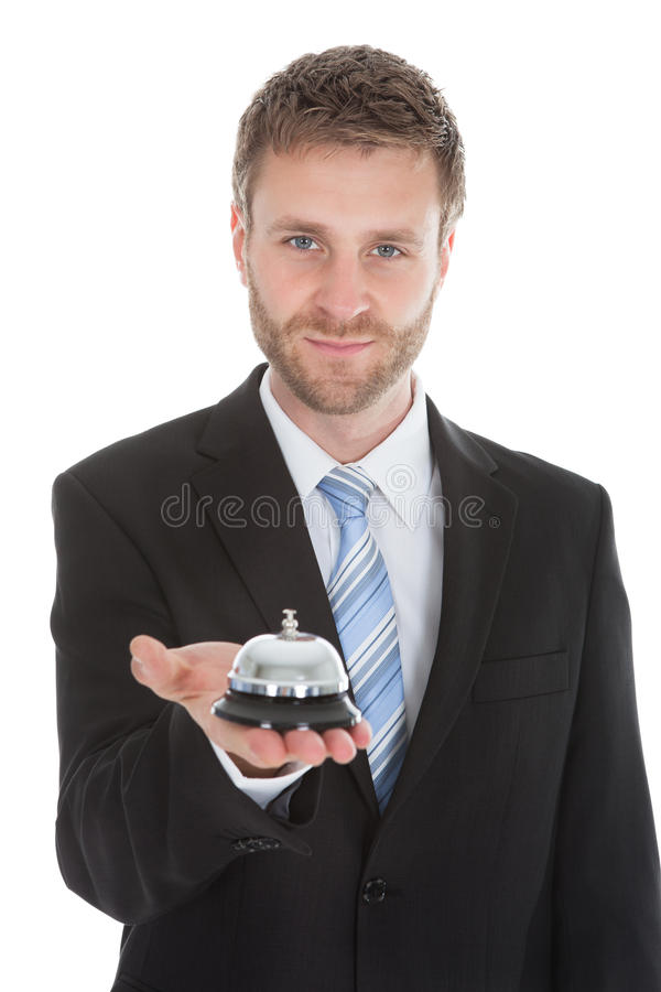 Confident Businessman Holding Service Bell stock images