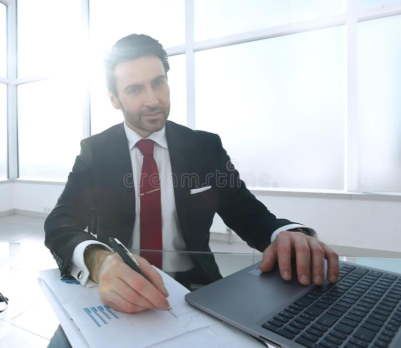 Confident businessman making a financial report stock photo