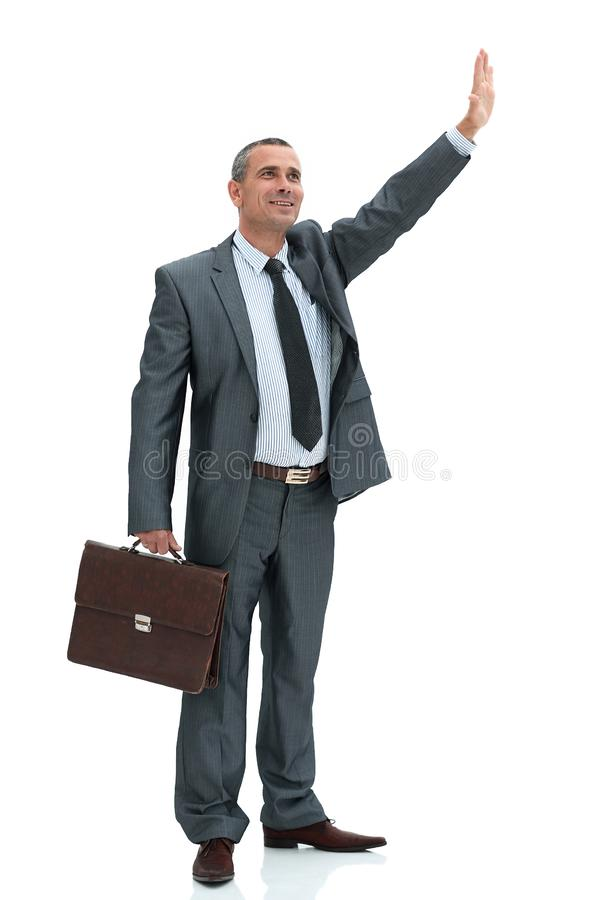 Confident businessman making a welcoming hand gesture royalty free stock image