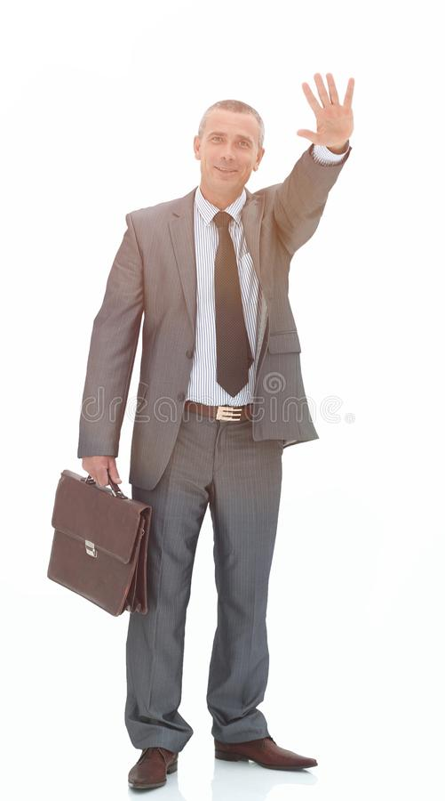 Confident businessman making a welcoming hand gesture stock images