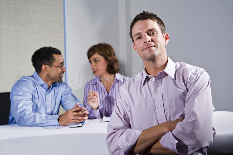 Confident Businessman In Meeting Stock Photo