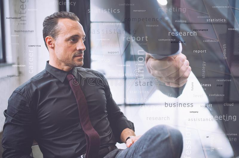 Confident businessman during a meeting. He watches far for future business vision. Handshake with partner in overlay. Confident businessman during a meeting in royalty free stock images