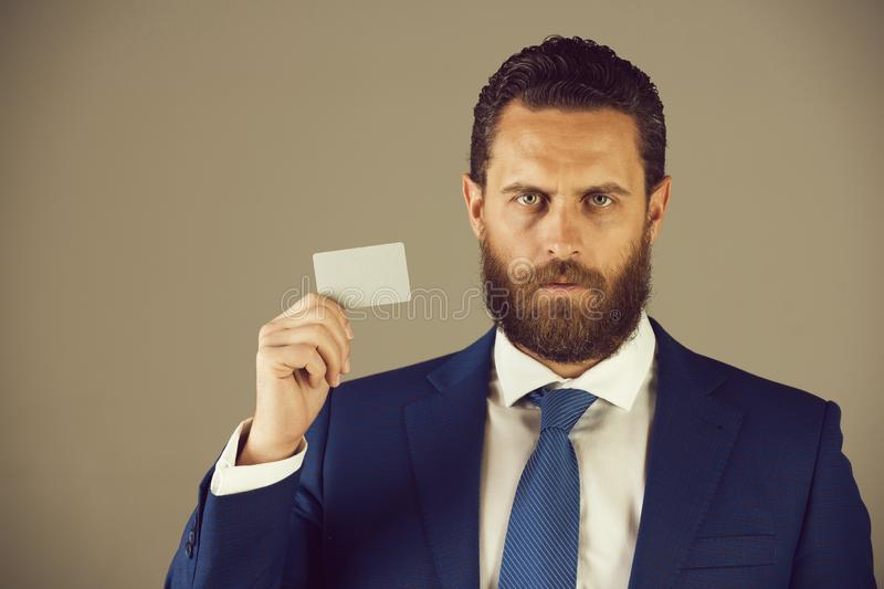 Confident businessman with silver business or credit card, business ethics. Business ethics. confident businessman or bearded man with silver business or credit stock photo