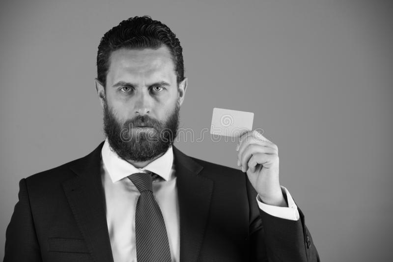 Confident businessman with silver business or credit card, business ethics. Business ethics. confident businessman or bearded man with silver business or credit royalty free stock photos