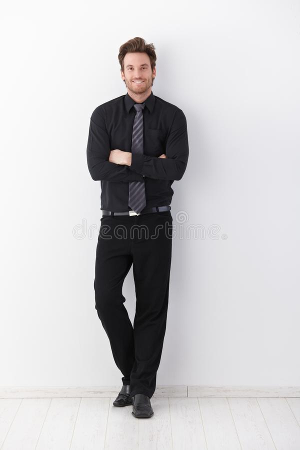 Confident businessman smiling arms crossed royalty free stock images