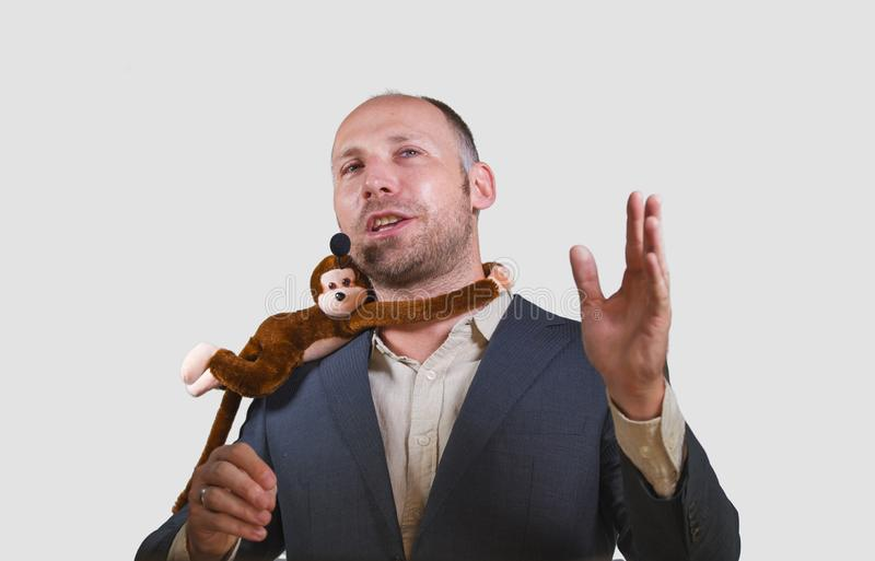 Confident businessman speaking at corporate business coaching and training auditorium conference room talking about monkey on. Young successful and confident stock photos