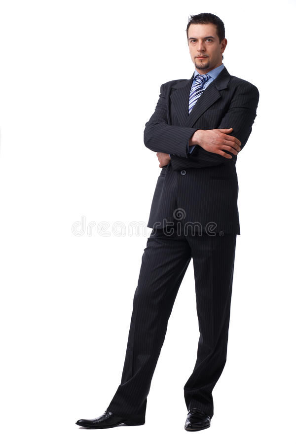 Download Confident Businessman Standing With Folded Hands. Stock Image - Image: 13862967