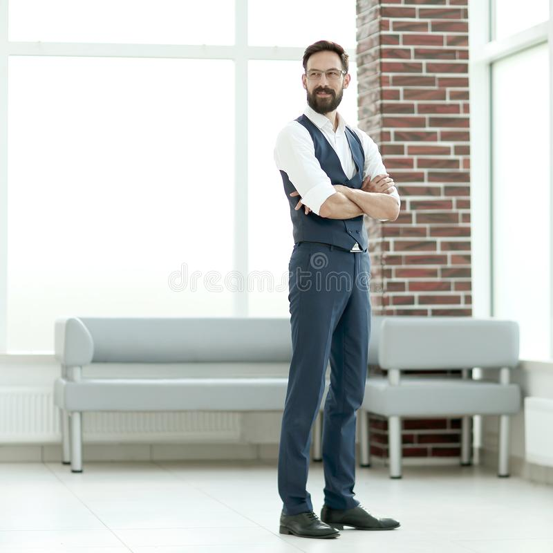 Confident businessman standing in the office lobby. Photo with copy space royalty free stock image