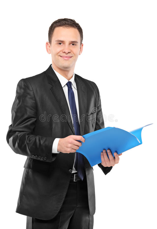 Confident Businessman In Suit Holding Document Royalty Free Stock Images