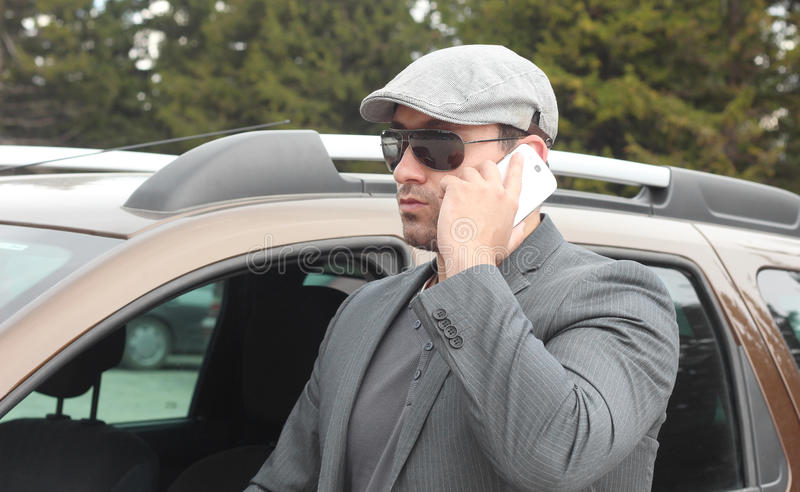 Confident businessman talking over the mobile phon