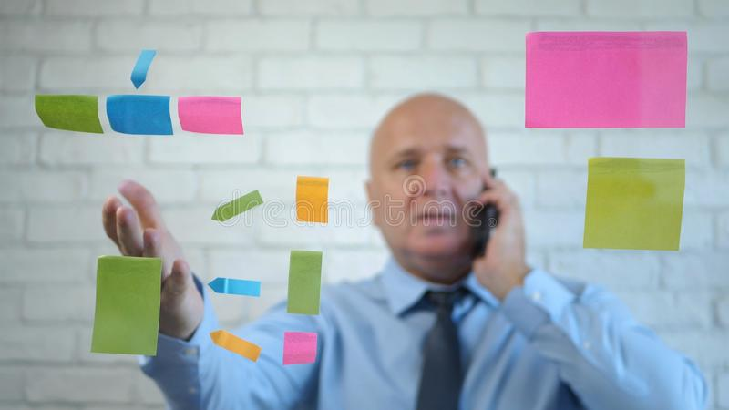 Confident Businessman Talking to Cellphone  Explain and Gesticulate stock photography
