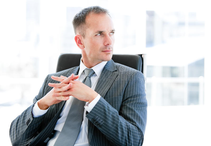 Confident businessman thinking about the company royalty free stock images