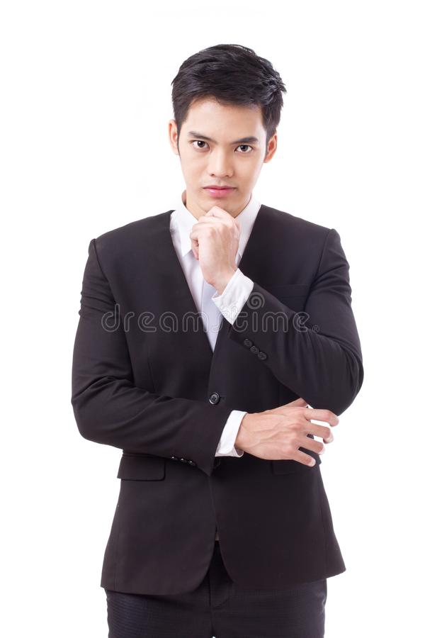 Confident businessman thinking crossing his arms stock image