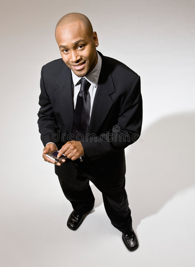 Download Confident Businessman Using Electronic Organizer Stock Photo - Image: 6601988