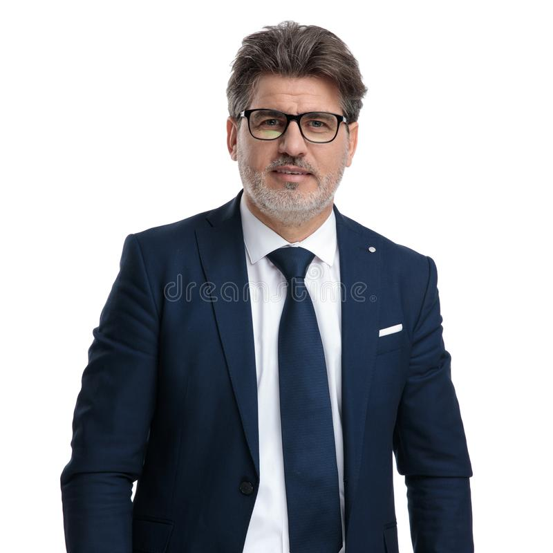 Confident businessman wearing glasses and a blue suit royalty free stock photos