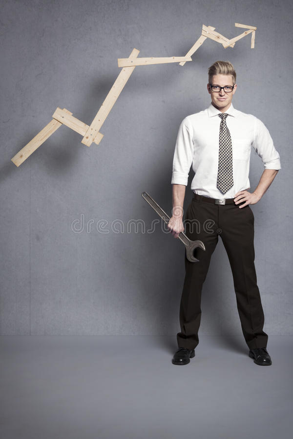 Download Confident Businessman With Wrench And Graph. Royalty Free Stock Images - Image: 28589409