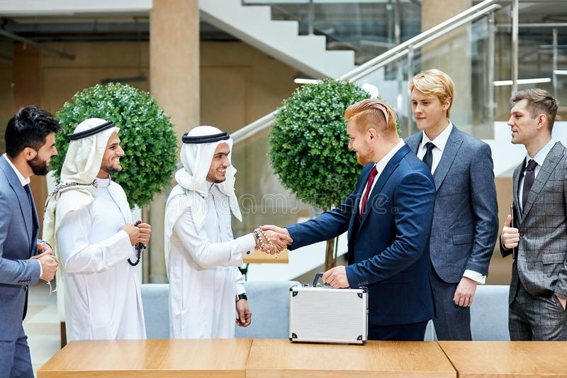 Business partners shake hands, business deal stock images