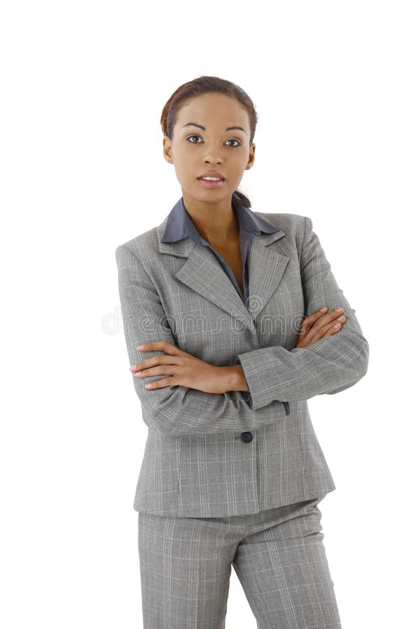 Confident businesswoman. Standing with arms crossed royalty free stock photo