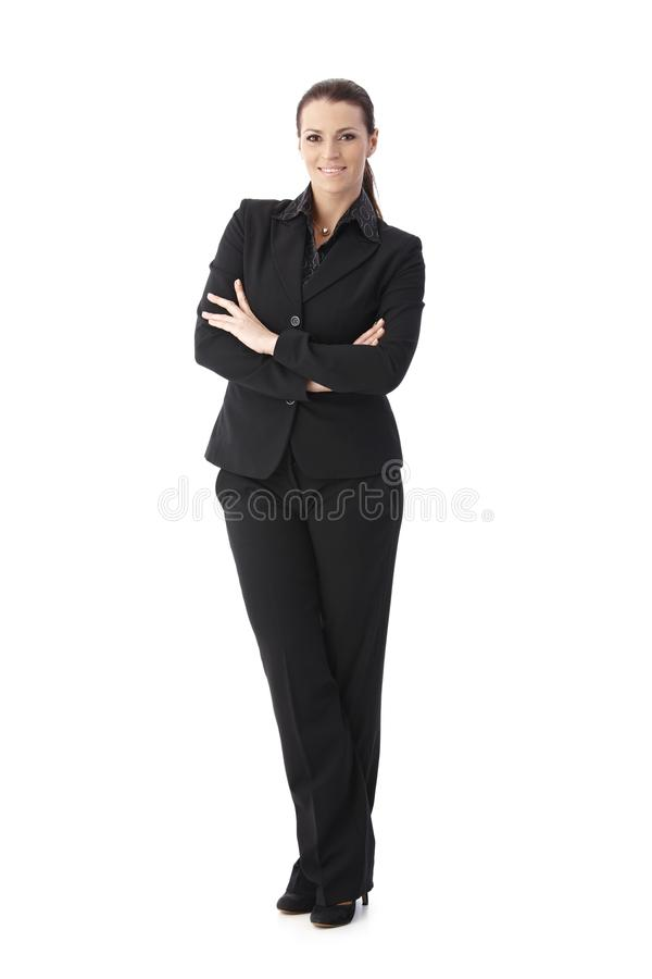 Confident businesswoman with arms crossed royalty free stock images
