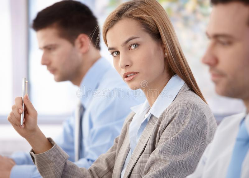 Confident businesswoman at business meeting stock image
