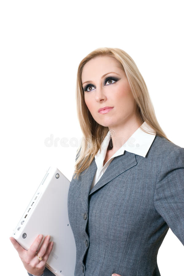 Confident businesswoman carrying computer laptop stock photo