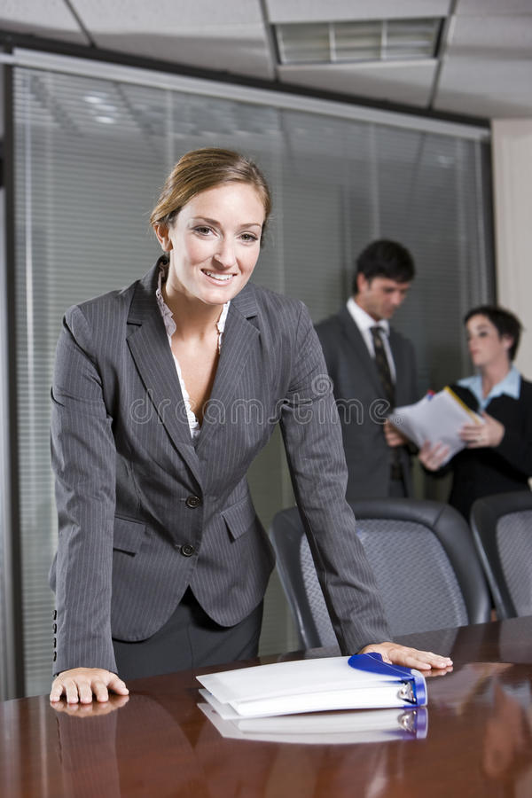 Download Confident Businesswoman, Colleagues In Background Royalty Free Stock Image - Image: 15846886