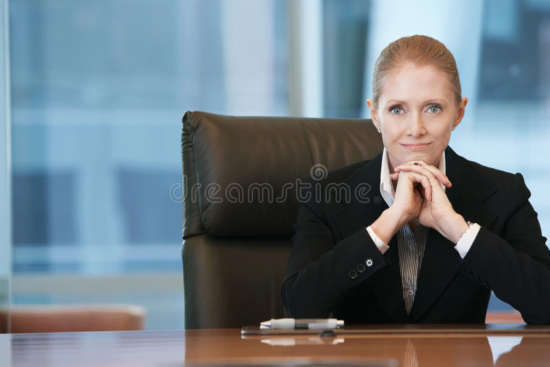 Confident Businesswoman At Conference Table royalty free stock photo