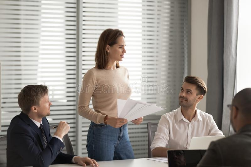 Confident businesswoman holding documents, mentor training staff at briefing stock photography