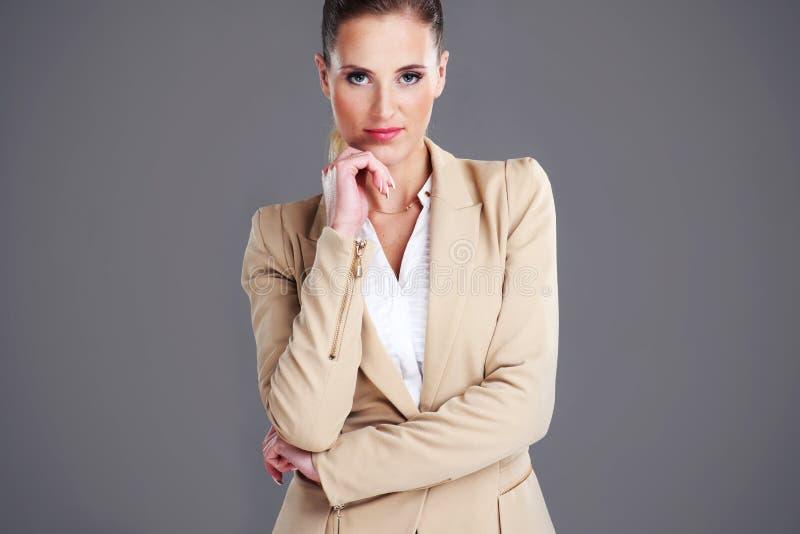 Confident businesswoman. Portrait of confident businesswoman over grey background stock images