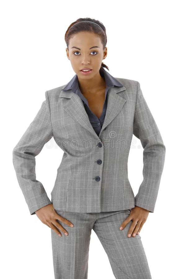 Confident businesswoman posing. Confident well dressed businesswoman posing in studio, looking at camera stock images