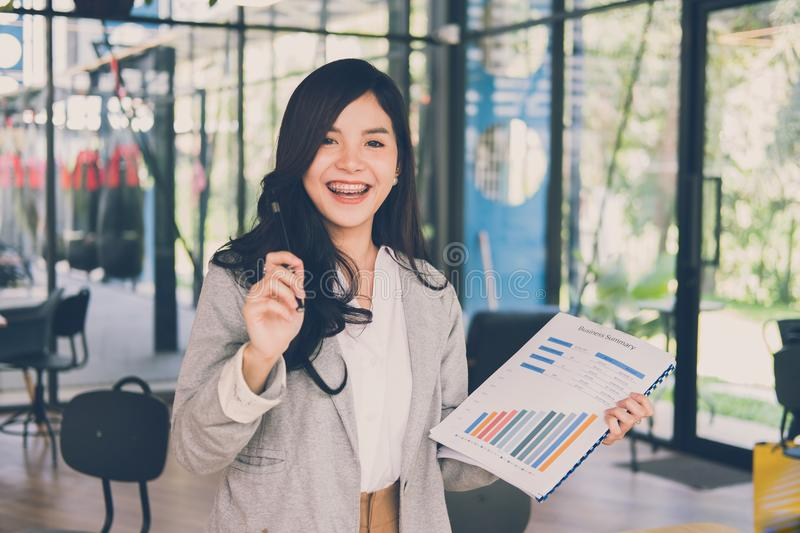 Confident businesswoman shows analytic accounting market chart a stock photo