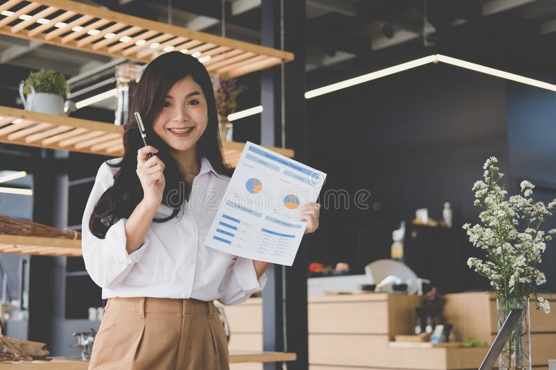 Confident businesswoman shows analytic accounting market chart a royalty free stock image