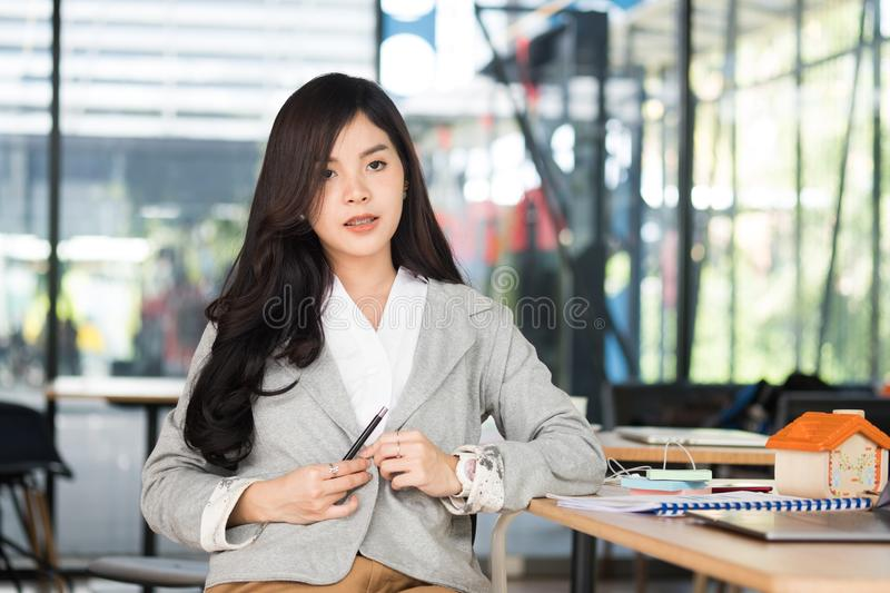 confident businesswoman sitting at office. young female entrepreneur woman have a break at workplace. working, business concept stock photo