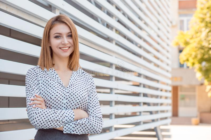 Confident businesswoman standing in the city next to office building outdoors royalty free stock photography
