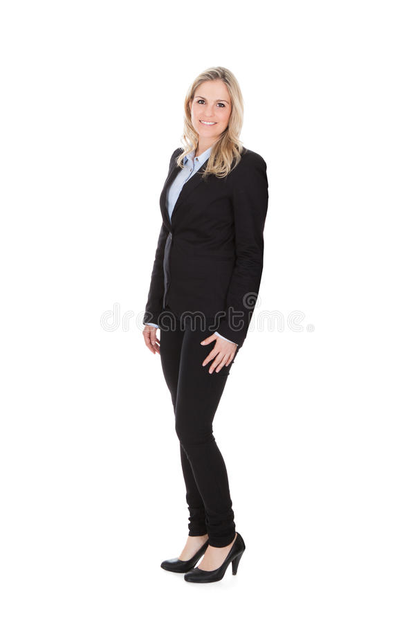 Confident Businesswoman Standing Over White Background stock photo