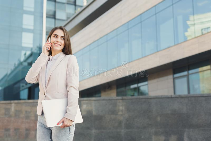 Confident young businesswoman talking on mobile royalty free stock image