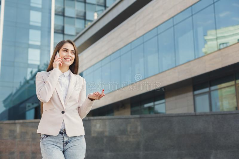 Confident young businesswoman talking on mobile stock photography