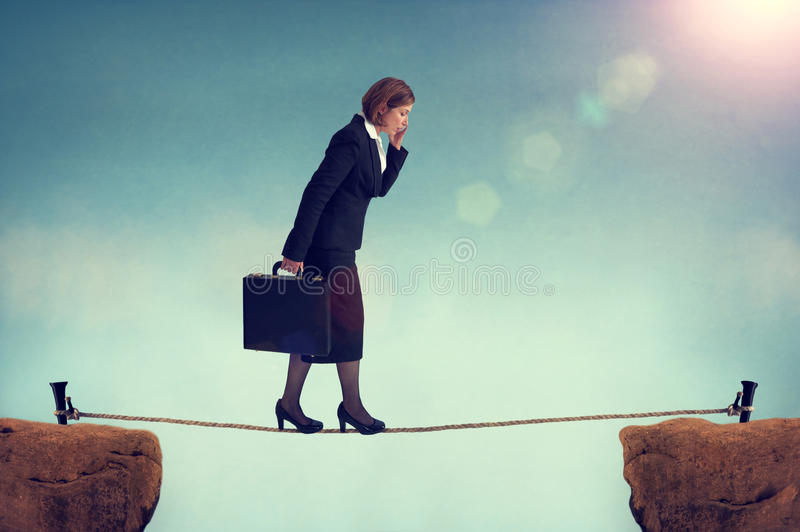 Confident businesswoman walking a tightrope. Or highwire multitasking stock photos