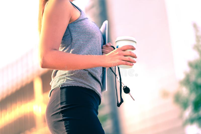 Confident businesswoman walking to work in city. Office worker, student, realtor or lawyer with coffee cup. Career woman. stock photos