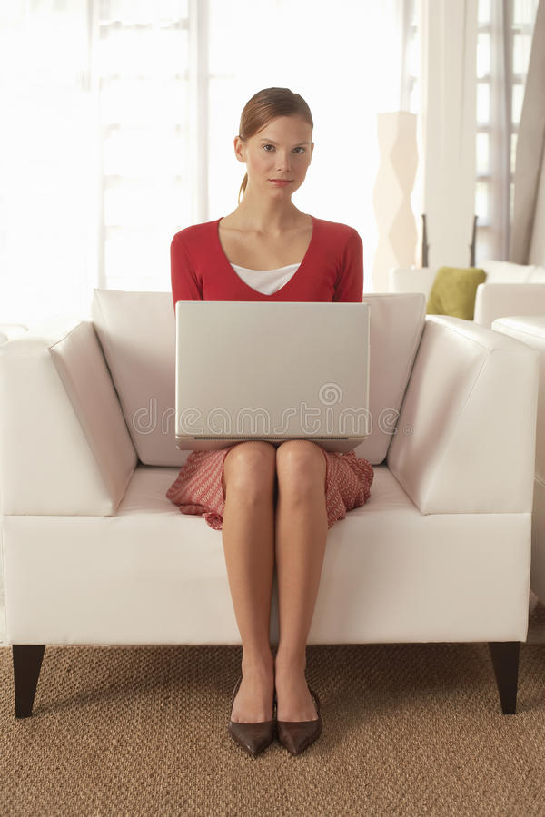Free Confident Businesswoman With Laptop Sitting On Chair Stock Images - 33890824