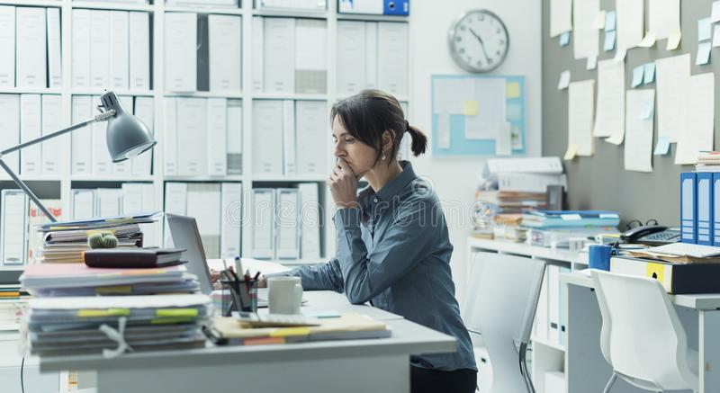 Businesswoman working in the office stock photos