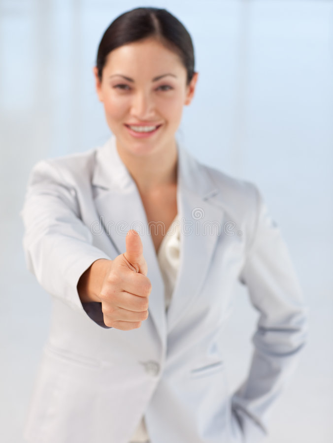Confident busineswoman being positive. Confident and attractive busineswoman being positive with thumb-up to camera stock images