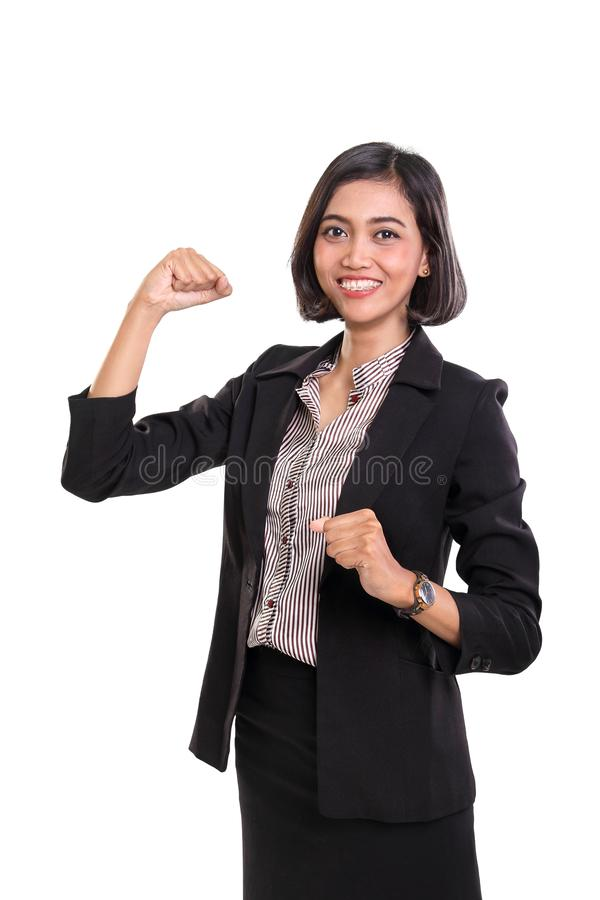 Confident career woman with arm raised up, showing optimism and enthusiasm royalty free stock photo
